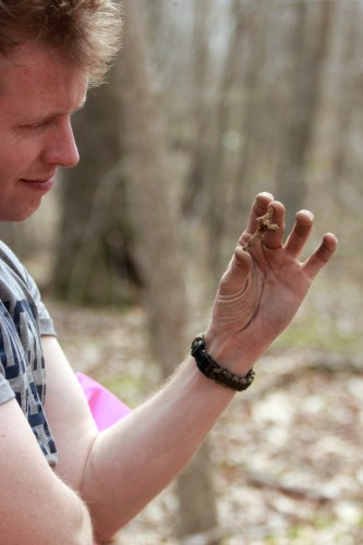 David Naumec '00 (CLAS), military historian with the Pequot Museum examines an iron artifact found on a Pequot War battlefield. (Mashantucket Pequot Museum & Research Center Photo)