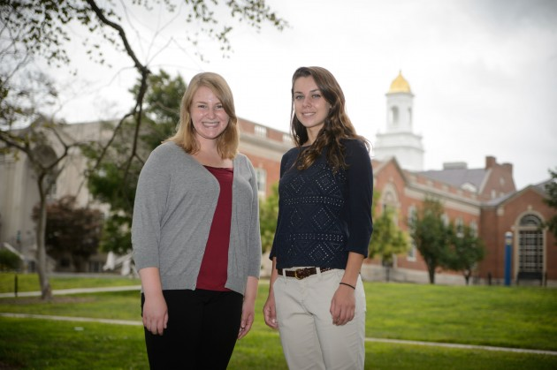 Incoming freshmen Megan Boyer and Sarah Robbins, a valedictorian and salutatorian respectively, from Manchester High School outside the Wilbur Cross Building on Aug. 22, 2014. (Peter Morenus/UConn Photo)