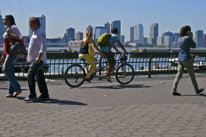 Walking and bicycling in urban settings promotes good health. (istock photo)