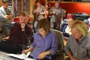 (L to R) Professor Kenneth Fuchs, conductor JoAnn Falletta, and producer Tim Handley, along with engineer Jonathan Allen, members of the London Symphony Orchestra, and Roderick Williams listen to a playback of 'Songs of Innocence and of Experience' in the control room of Abbey Road Studio 2. (Chris von Rosenvinge photo)