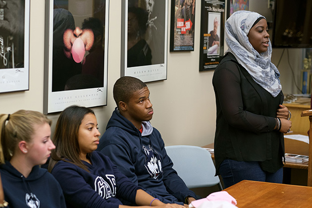 Haddiyyah Ali '18 (CLAS) recalls how she was affected when a high school classmate attempted suicide, during a Student Voices Panel, part of Suicide Prevention Week, at the African American Cultural Center on Sept. 25. (Peter Morenus/UConn Photo)