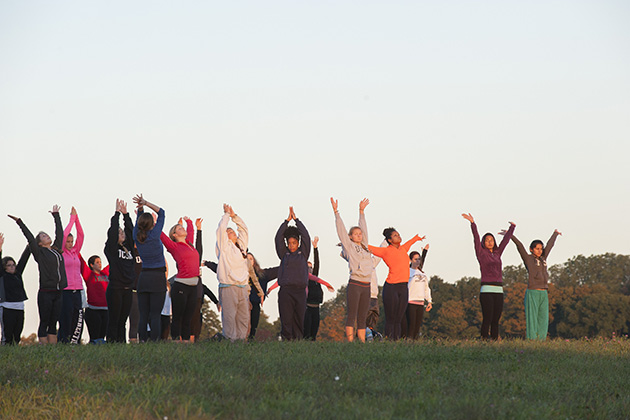 Sunrise yoga on horsebarn Hill on Sept. 22. (Sean Flynn/UConn Photo)