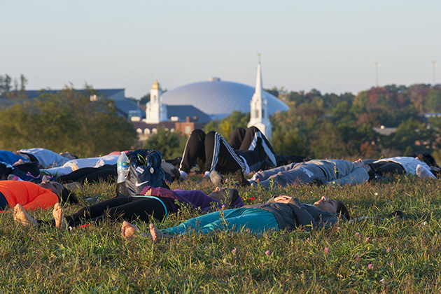 Sunrise yoga on horsebarn Hill onSept. 22, 2014. (Sean Flynn/UConn Photo)