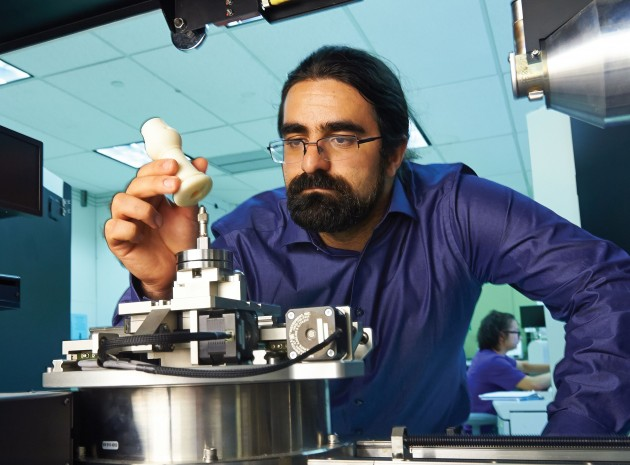 Sina Shahbazmohamadi '13 Ph.D. has developed a new method for using micro-computed tomography in UConn's Center for Clean Energy Engineering to examine antique wind instruments and then create new parts using 3-D printing technology. (Sean Flynn/UConn Photo)