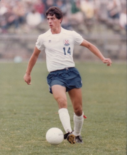 Tony Rizza '87 (BUS) playing soccer. He was on the UConn men's soccer team from 1983 to 1986. (Division of Athletics/UConn File Photo)