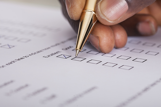 Close-up of a person filling out a survey form. (iStock/UConn Photo)