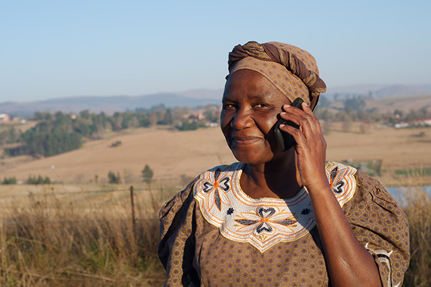 An African woman uses a cell phone. (Shutterstock Photo)