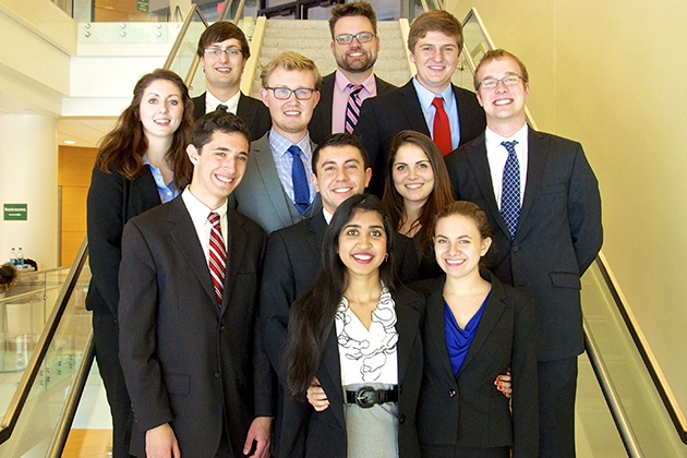 The UConn Moot Court Team 2014. By row from back: Luke LaRosa, Edward Kammerer Jr. (coach); Katie Cavanaugh '17 (CLAS), Leon Peschel '16 (BUS), Christopher Baker '16 (CLAS), Jared Quigley '18 (CLAS); Ryan Norton '17 (CLAS), Alexander Loukellis '17 (BUS), Danielle Ullo '17 (CLAS); Snigdha Mamillapalli '16 (BUS), Santorini Rivera '16 (CLAS), all Honors students. (Honors Program/UConn Photo)