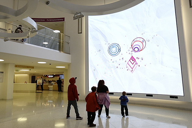 An interactive digital wall in the lobby of Boston Children's Hospital was designed by researchers at the University of Connecticut.