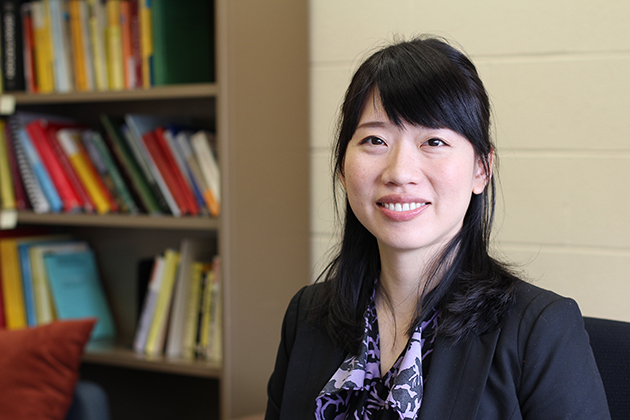 Lan-Hsuan Huang, assistant professor of mathematics, uses complex math at the intersection of geometry and calculus to understand the shape of the universe. (Christine Buckley/UConn Photo)