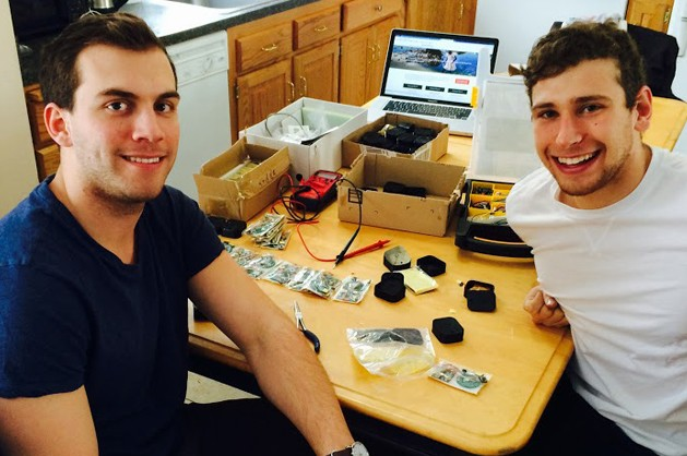 Charles Fayal '16 (ENG), left, and Steven Graf '15 (BUS) take a break from assembling their Parrot MD devices.