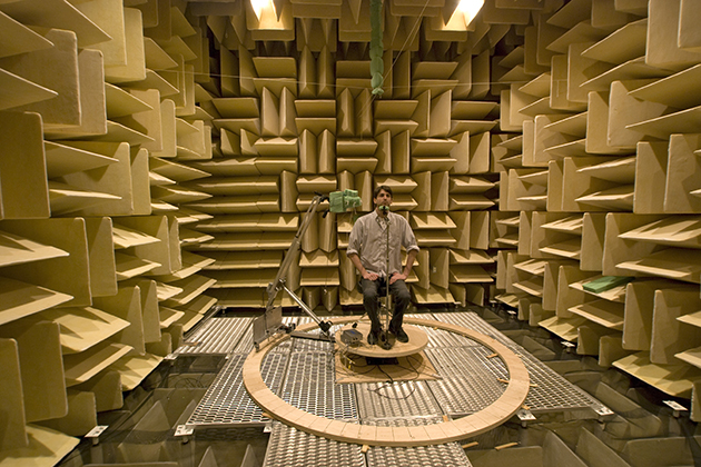 A human subject in an anechoic (echo-free) chamber at UConn Health. (Photo courtesy of Duck Kim)