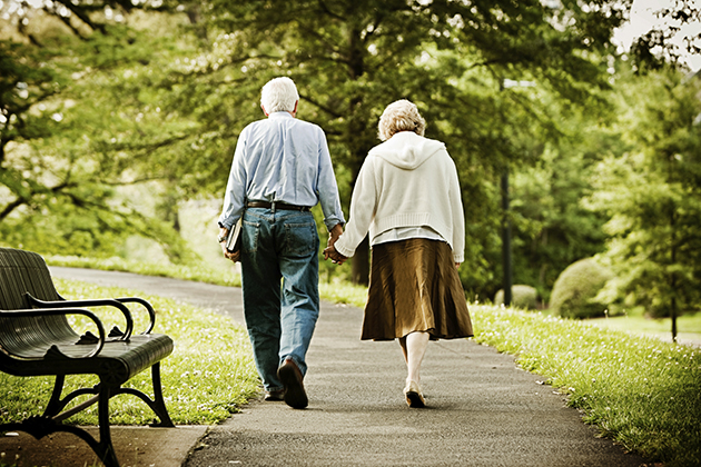 Elderly couple walking in a park. (iStock Photo)