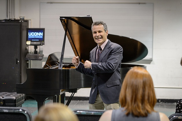 Eric Rice, chair of the music department talks before a performance on a new Steinway & Sons grand piano just delivered to the Music Building on May 7, 2015. (Peter Morenus/UConn Photo)