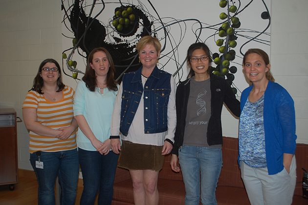 UConn Health geneticist Stormy Chamberlain, right, with from left, Carissa Sirois (Ph.D. student), Noelle Germain (post-doc), Roberta Burns (visitor with the Angelman group), and Pin-Fang Chen (Ph.D. student). (Barbara Glassman Dell for UConn)