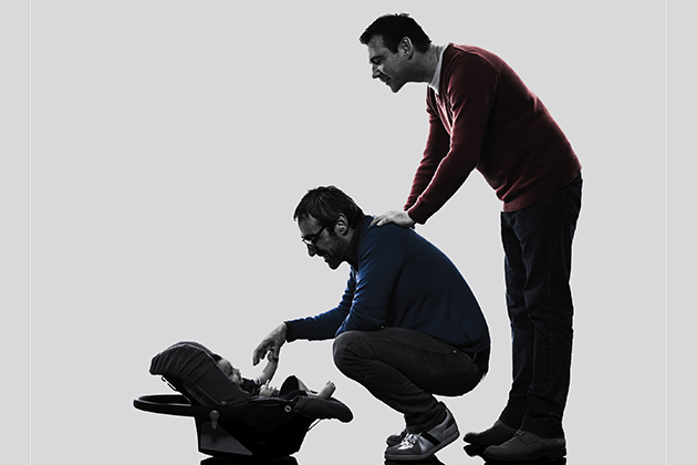Male parents with a baby. (iStock Photo)