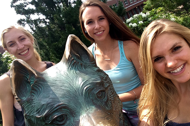 Laura, Kat, and me posing with Jonathan post-good-luck nose rub at Wolff Family Park. (Abby Mace/UConn Photo)