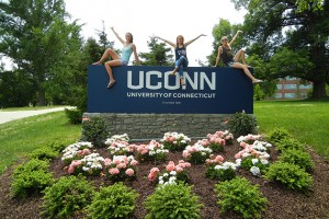 Me and my friends and teammates on the UConn Track & Field Team Laura and Kat, perch on top of the UConn sign at the corner of North Eagleville and Storrs Roads. (Abby Mace/UConn Photo)