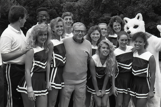 President Harry Hartley with cheerleaders at the President's picnic, in September 1990. (University of Connecticut Photograph Collection, Archives & Special Collections, UConn Libraries)