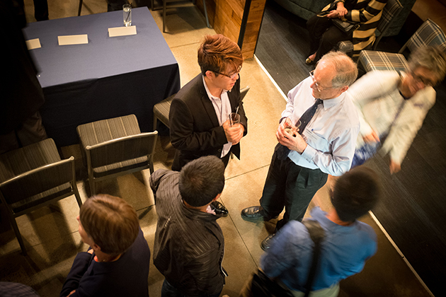 Anson Ma speaks with guests following the event. (Peter Morenus/UConn Photo)