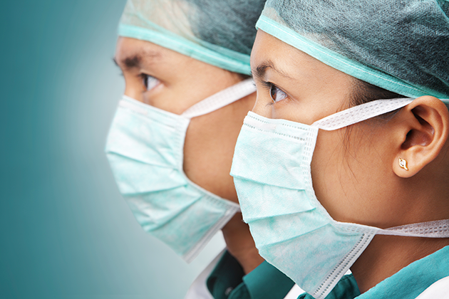 Two Asian physicians wearing protective masks. (iStock Photo)