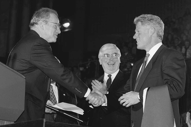 Clinton received an honarary degree after his address.  Trustee Chair Lewis Rome, left, presented the President with the degree, to the delight of U.S. Sen. Christopher Dodd.