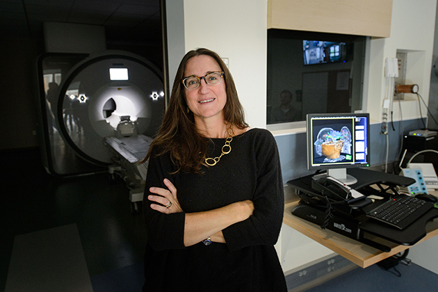 Inge-Marie Eigsti with the new FMRI at the Philips Communication Sciences Building on Sept. 28, 2015. (Peter Morenus/UConn Photo)