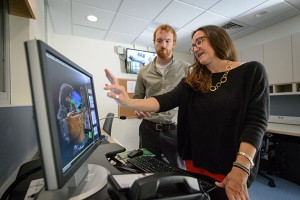 Inge-Marie Eigsti and John Green, a third year Ph. D. student, with the new FMRI at the Philips Communication Sciences Building on Sept. 28, 2015. (Peter Morenus/UConn Photo)