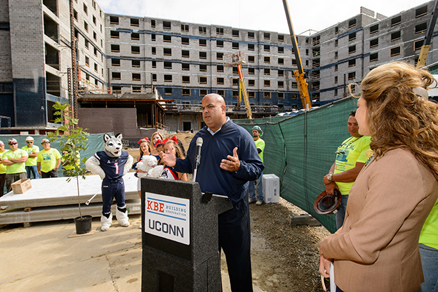 Warde Manuel, director of athletics, speaks during the topping off ceremony for the STEM residence hall on Sept. 14, 2015. (Peter Morenus/UConn Photo)