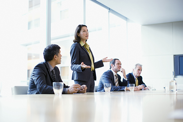 Businesswoman giving presentation in conference room. (iStock Photo)