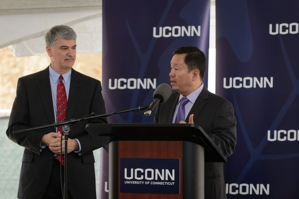 Provost Mun Chois introduces former state senate president pro tempore Don Williams at the groundbreaking ceremony for the Innovation Partnership Building on Oct. 14, 2015. (Peter Morenus/UConn Photo)
