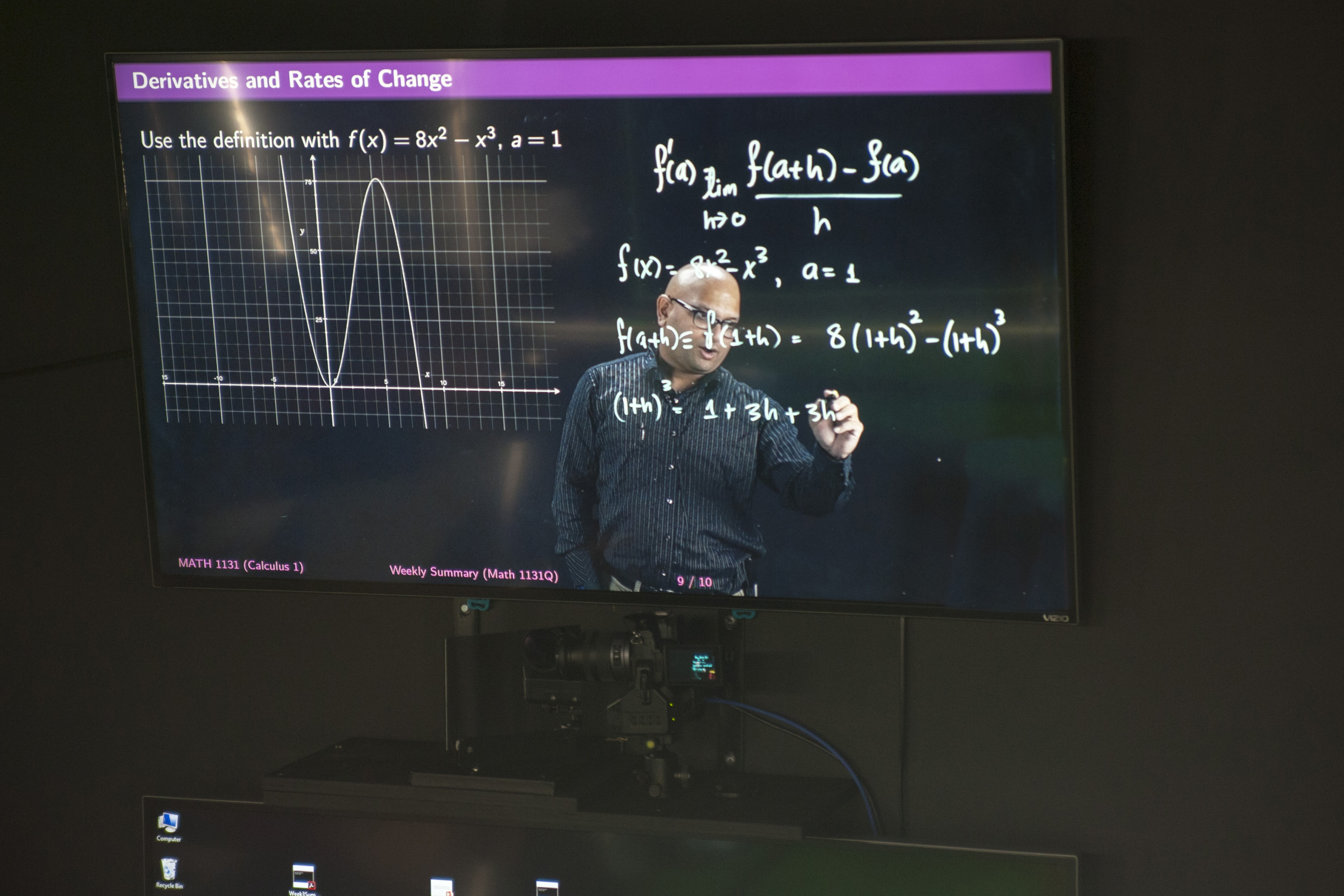 Amit Savkar, assistant professor-in-residence of math, tapes a lecture using Lightboard technology on Sept. 18, 2015. (Sean Flynn/UConn Photo)