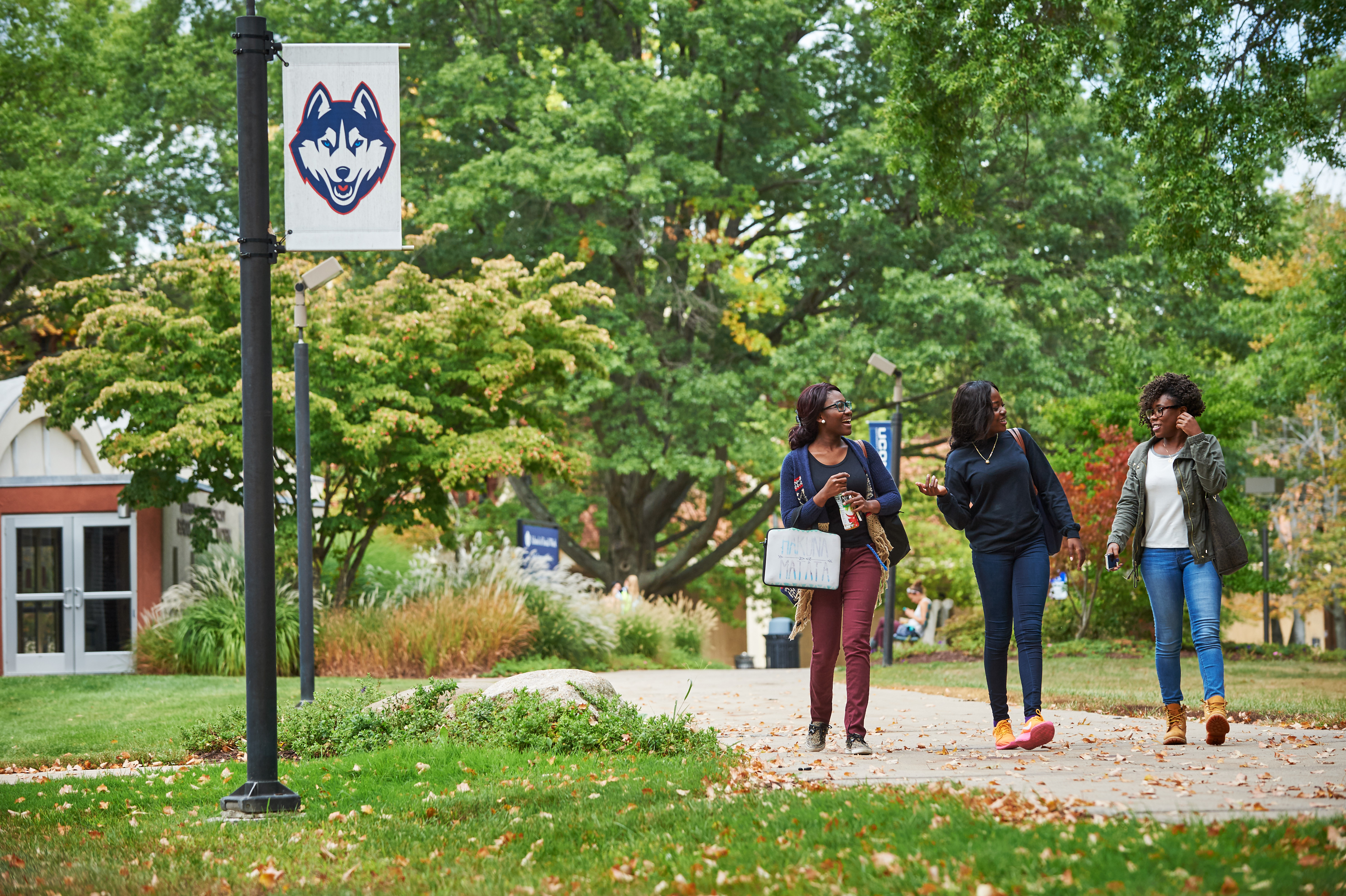 Students walk outdoors near banners on the Hartford campus. (Peter Morenus/UConn Photo)