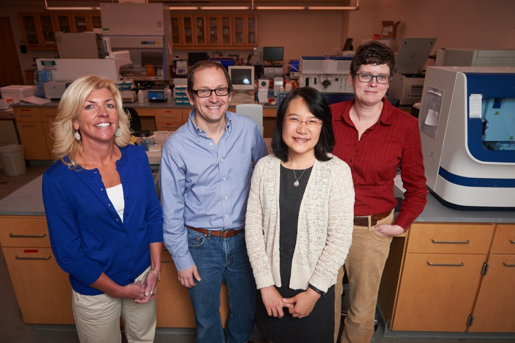 Susan Janton, left, Joerg Graf, Xiaomei Cong, and Kendra Maas, at the Microbial Analysis, Resources and Services lab. (Peter Morenus/UConn Photo)