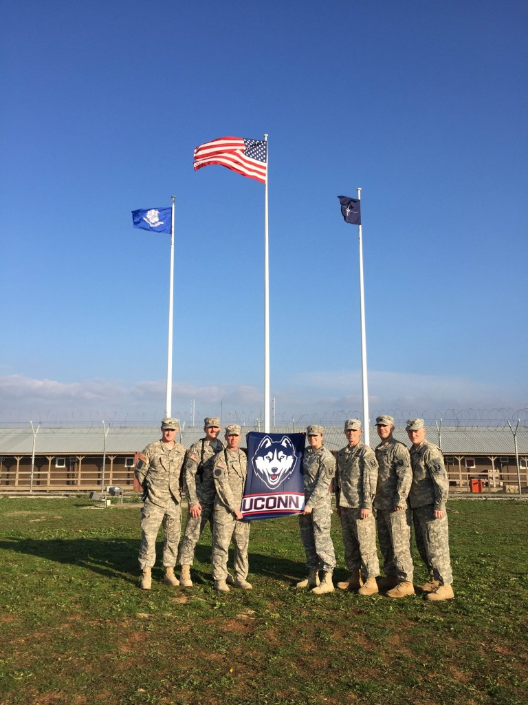 These members of Husky Nation show their pride in UConn while serving in Kosovo. (Photo courtesy of Krista Yaglowski)
