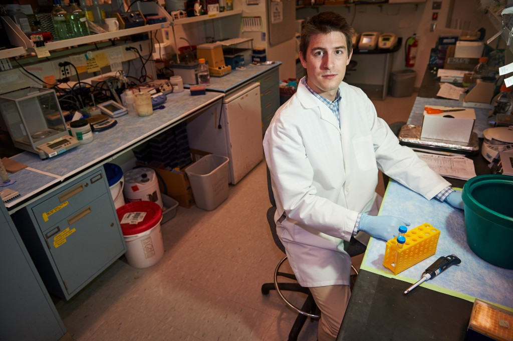 Fourth-year doctoral student Matthew Hanley in a lab at UConn Health in Farmington on Dec. 3, 2015. (Peter Morenus/UConn Photo)