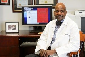 Dr. Cato Laurencin at his office at UConn Health in Farmington on Oct. 6, 2014. (Peter Morenus/UConn Photo)
