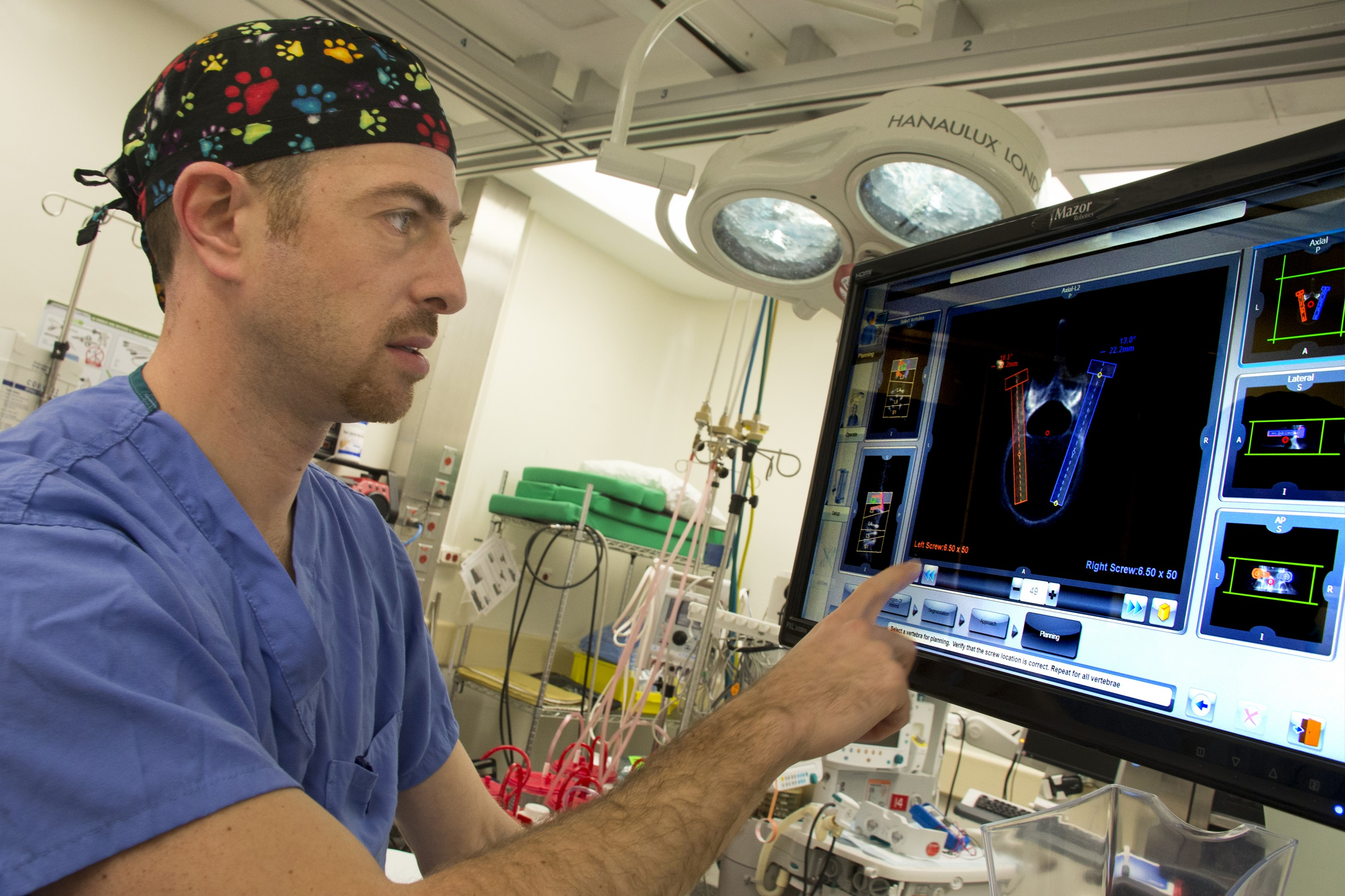 Dr. Isaac Moss of the UConn Musculoskeletal Institute will be New England's and Connecticut's first surgeon to use pioneering robotic guidance technology to assist him during spine surgery at UConn John Dempsey Hospital. (Janine Gelineau/UConn Health Photo)