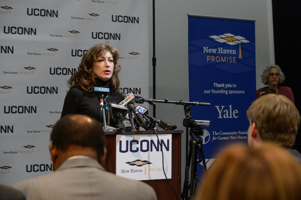 President Susan Herbst speaks during an event to announces an additional financial commitment for New Haven Promise students held at the Cooperative Arts and Humanities High School in New Haven on Dec. 1, 2015. (Peter Morenus/UConn Photo)