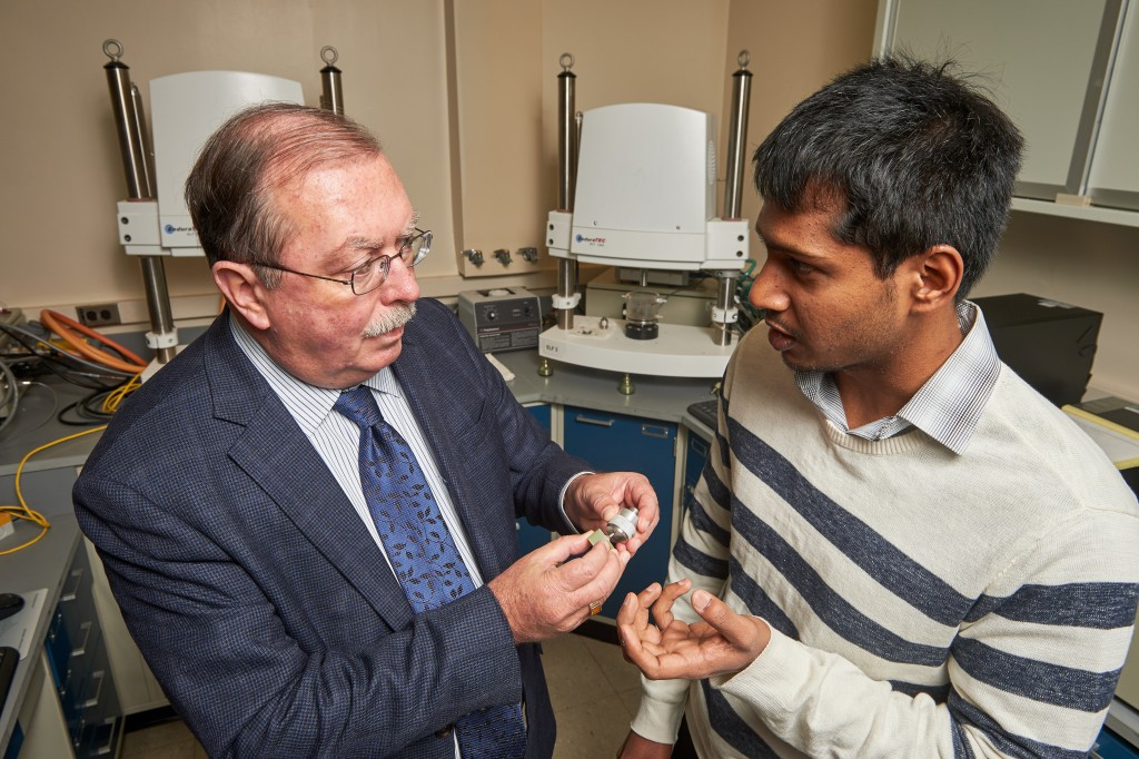 Gopinath Rajadinakaran, right, and Robert Kelley, professor of reconstructive sciences, discuss the testing of an artificial salivary gland at UConn Health in Farmington on Dec. 3, 2015. (Peter Morenus/UConn Photo)