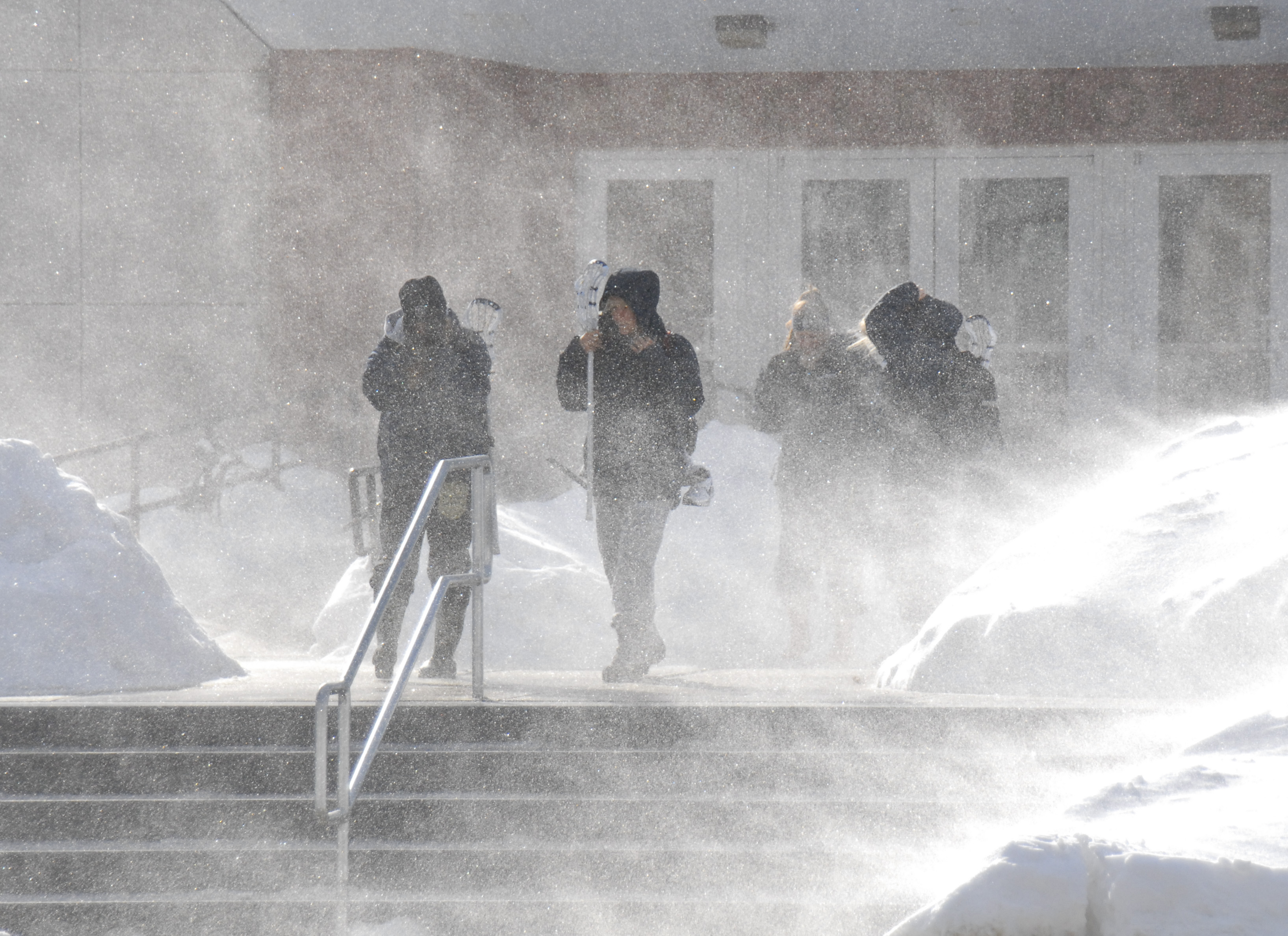 Students are overwhelmed with snow as they exit the Field House. (UConn File Photo)