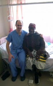 Dr. Isaac Moss, UConn Health orthopaedic spine surgeon, with a patient at Kenyatta National Hospital in Nairobi, Kenya. (Photo provided by Dr. Isaac Moss).