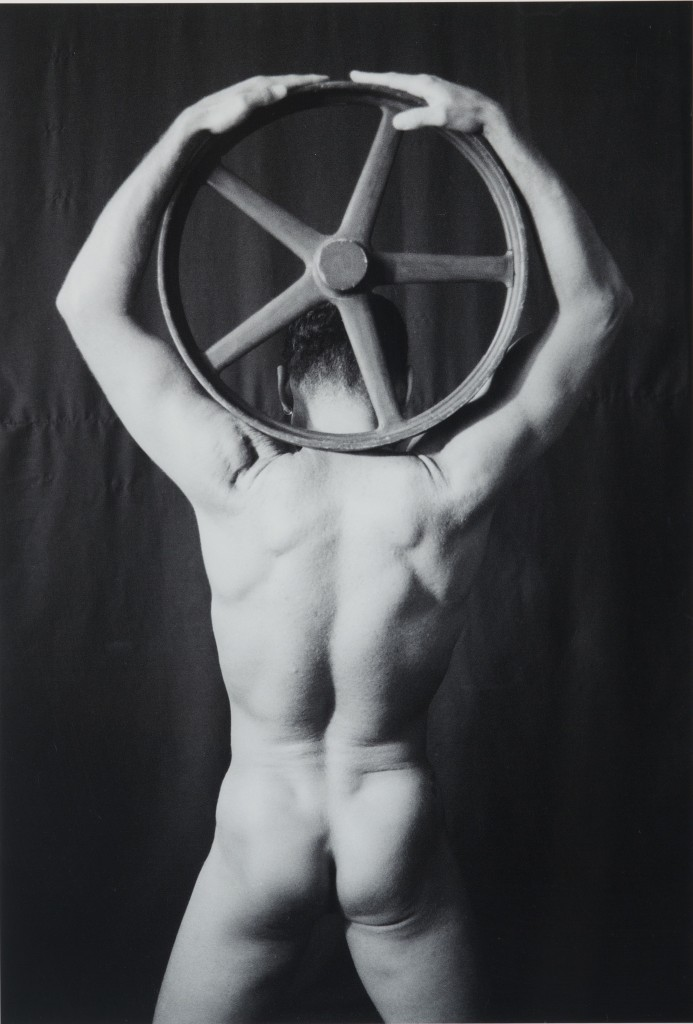 Male Nude with Wooden Wheel, 1988, Roger L. Crossgrove, gelatin silver print. (Benton Museum/UConn Photo)