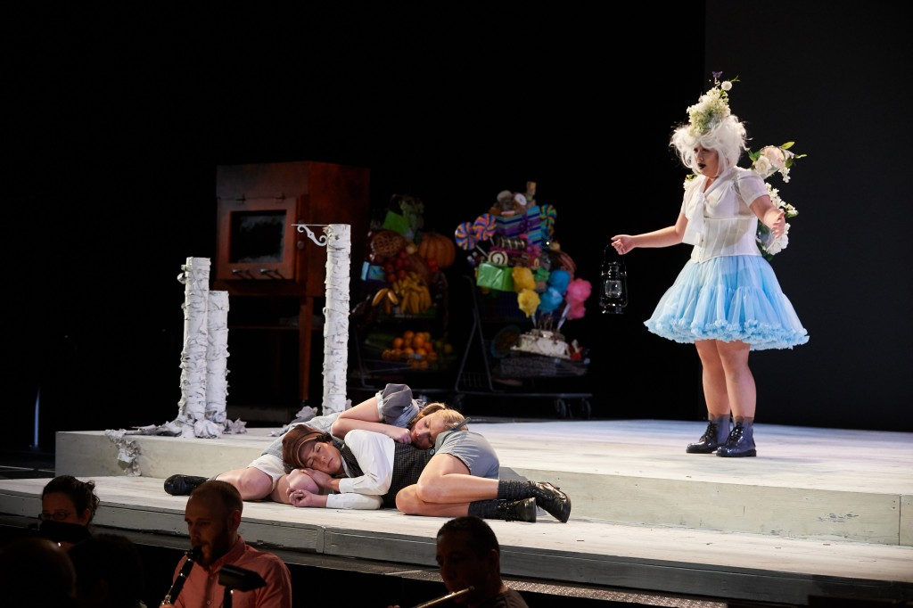 Soprano Candice Chung as the Dew-Fairy is startled to find Hansel and Gretel sleeping in the woods, in UConn Opera's presentation of 'Hansel and Gretel,' which opens at Jorgensen on Jan. 30. (Peter Morenus/UConn Photo)