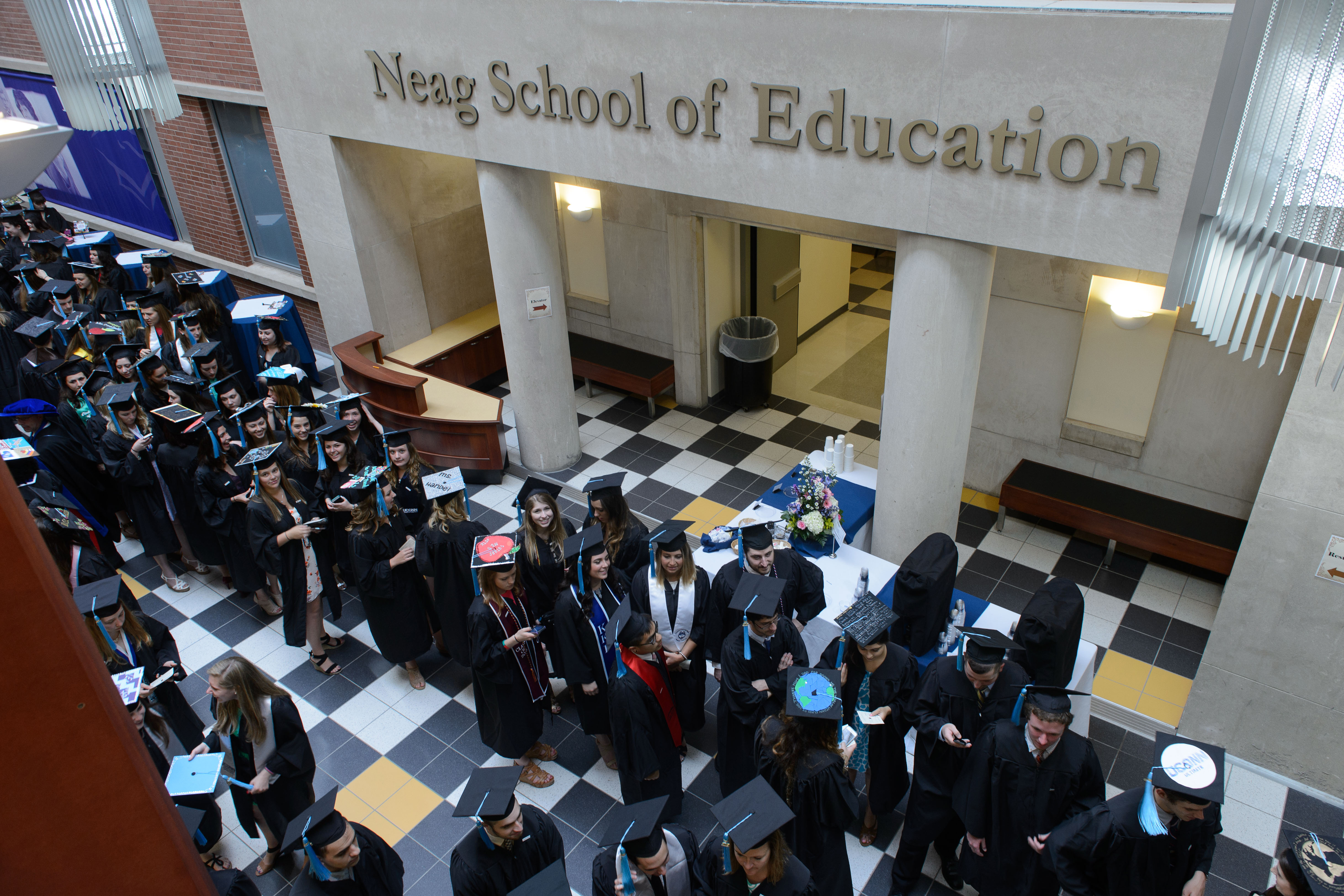 Neag School of Education degree candidates prepare for their Commencement procession at the Gentry Building on May 10, 2015. (Peter Morenus/UConn Photo)