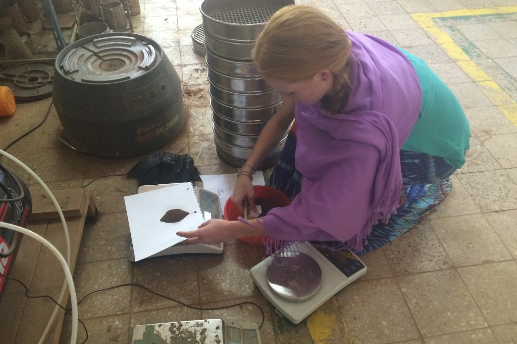 Kristin Burnham '19 (ENG, CLAS) measures soil samples to later test the soil's water capacity in a soil lab at Bahir Dar University. The mechanical shaker behind her is used to determine how much rock and gravel are present in the soil.