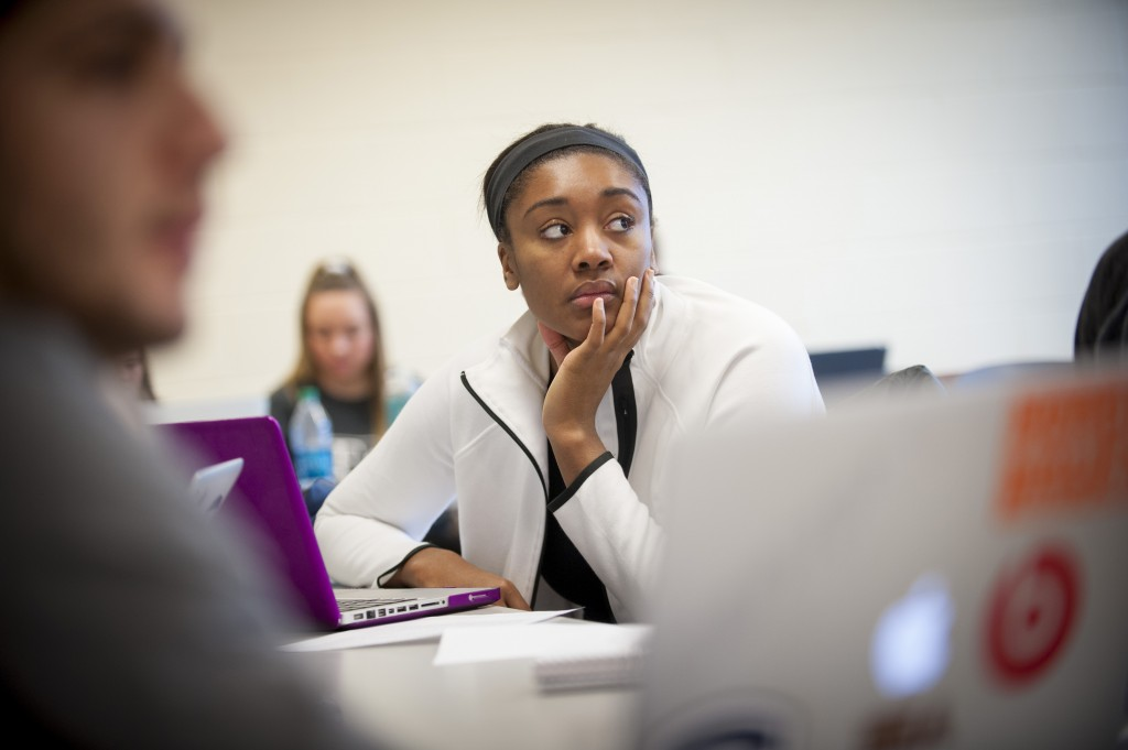 Student-athlete Morgan Tuck in an introduction to sports communication class in Gentry Building on Feb. 17, 2016. (Sean Flynn/UConn Photo)