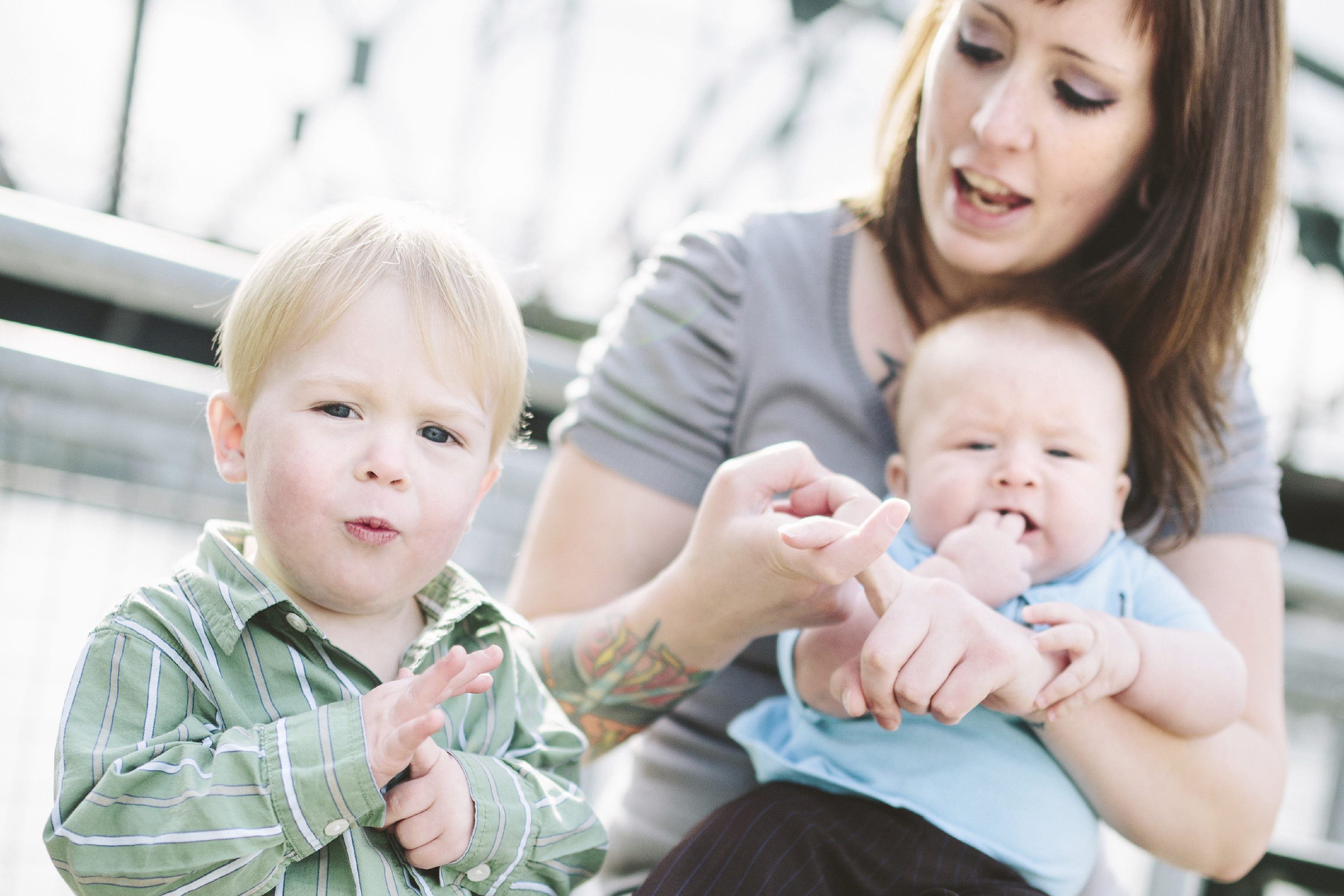 A parent using sign language with a young child. (iStock Photo)
