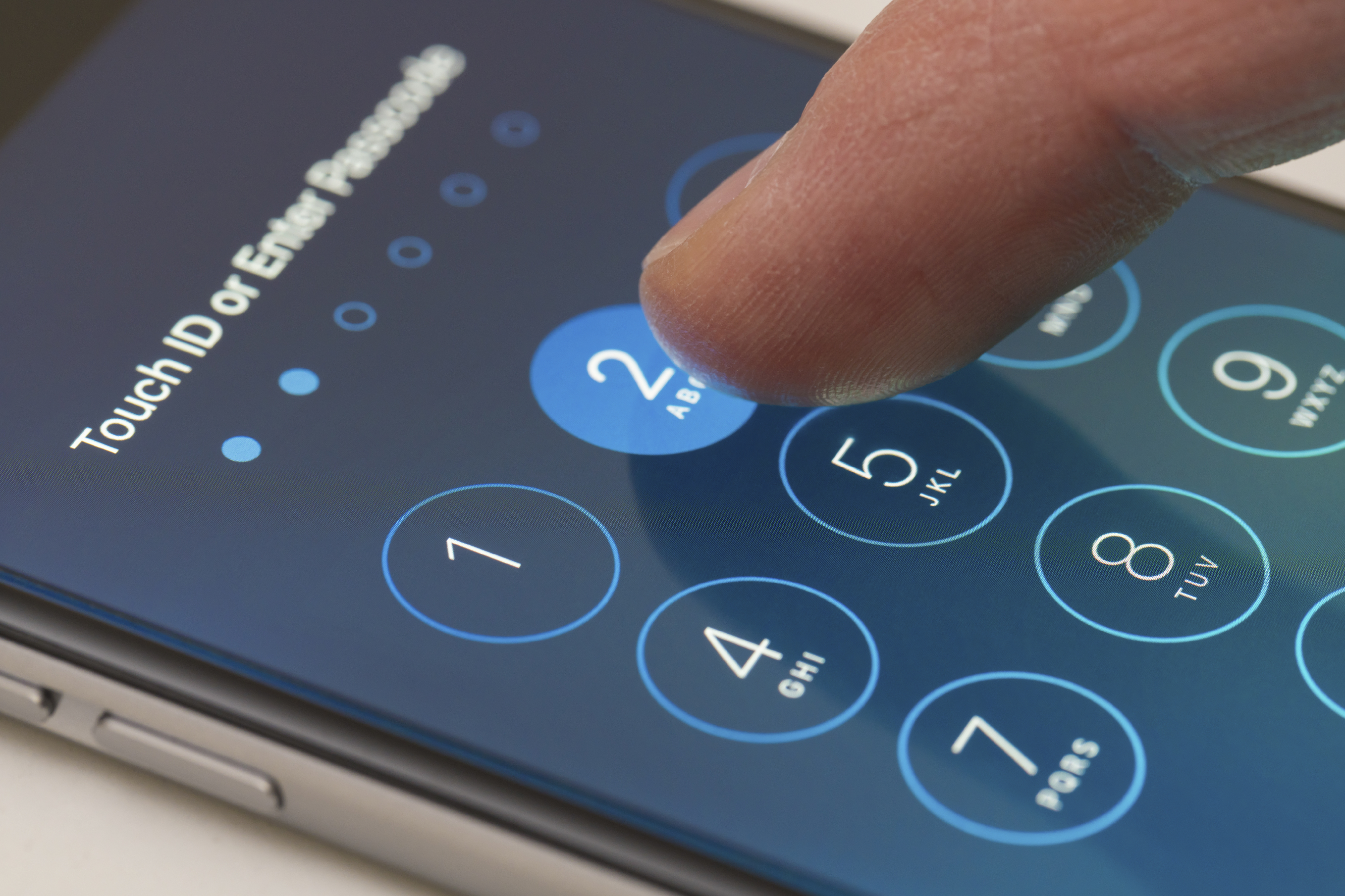 Entering a passcode on an iPhone running iOS9. (iStock Photo)