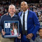 Former Husky Caron Butler celebrates his induction into Huskies of Honor along with his former coach, Jim Calhoun, and his daughter. (UConn Athletic Communications Photo)